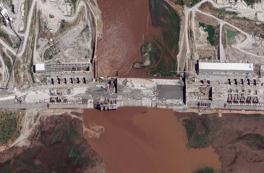 """FILE - This satellite image taken Thursday, May 28, 2020, shows the Grand Ethiopian Renaissance Dam on the Blue Nile river in the Benishangul-Gumuz region of Ethiopia. Egypt wants the United Nations Security Council to """"undertake its responsibilities"""" and prevent Ethiopia from starting to fill its massive, newly built hydroelectric dam on the Nile River next month amid a breakdown in negotiations, Egyptian Foreign Minister Sameh Shukry told The Associated Press on Sunday, June 21, 2020 accusing Ethiopian officials of stoking antagonism between the countries. (Maxar Technologies via AP, File)"""