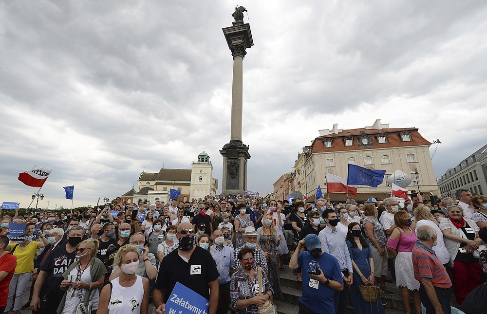 Supporters attend a rally of a candidate in Poland's presidential election, Warsaw centrist Mayor Rafal Trzaskowski on the last day of campaigning before Sunday's vote, in Castle Square in Warsaw, Poland, on Friday, June 26, 2020. Trzaskowski is a major challenger to incumbent conservative President Andrzej Duda who is seeking a second five-year term and is leading in the polls. (AP Photo/Czarek Sokolowski)