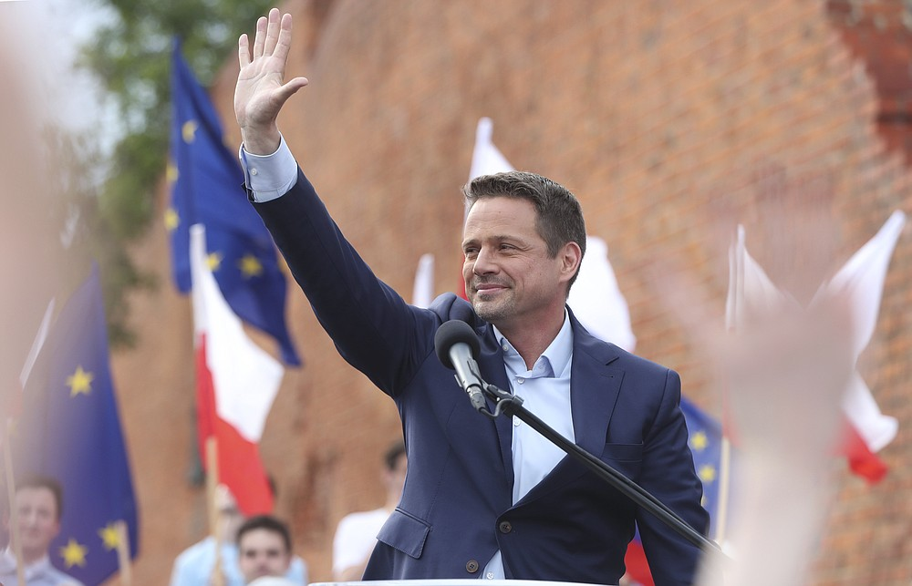 Candidate in Poland's presidential election, Warsaw centrist Mayor Rafal Trzaskowski addresses supporters on the last day of campaigning before Sunday's vote, in Castle Square in Warsaw, Poland, on Friday, June 26, 2020. Trzaskowski is a major challenger to incumbent conservative President Andrzej Duda who is seeking a second five-year term and is leading in the polls.(AP Photo/Czarek Sokolowski)