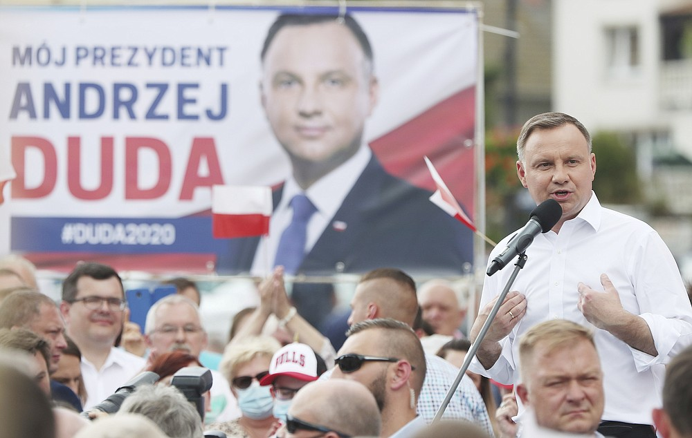 Polish President Andrzej Duda waves to supporters as he campaigns for a second term in Serock, Poland, on Wednesday, June 17, 2020.Duda is the frontrunner ahead of the election on Sunday, June 28, but is not expected to reach the 50 percent threshold needed to win outright. That will require a runoff two weeks later in which he is expected to face off against Warsaw Mayor Rafal Trzaskowski in a very close race.(AP Photo/Czarek Sokolowski)