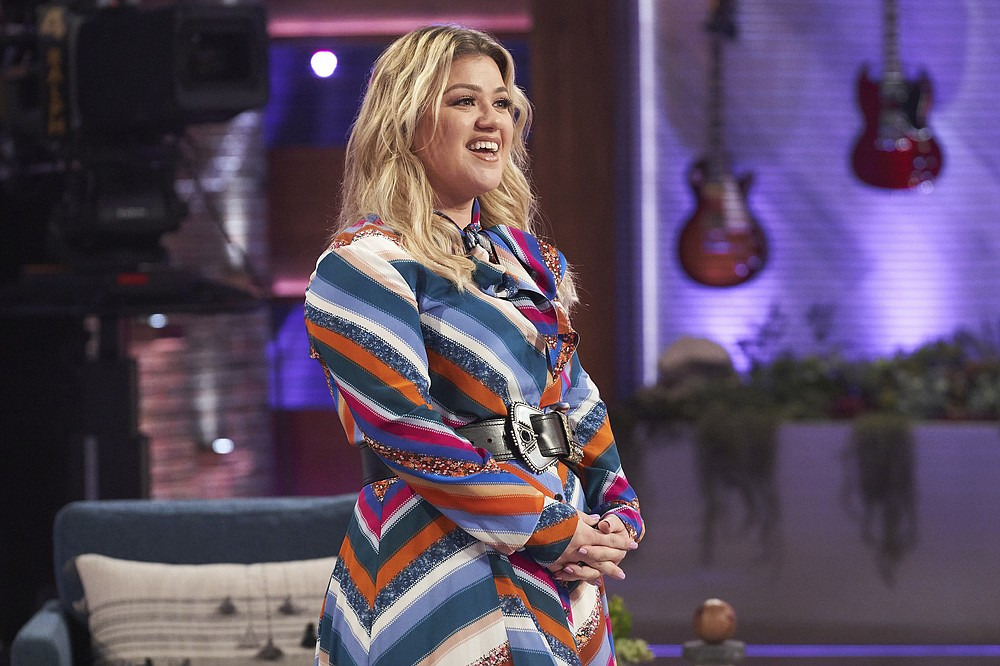 """This image released by NBC shows Kelly Clarkson on the set of her syndicated talk show """"The Kelly Clarkson Show."""" Clarkson won an Emmy for outstanding entertainment talk show host for """"The Kelly Clarkson Show"""" at the 47th annual Daytime Emmy Awards.  (Adam Christopher/NBCUniversal via AP)"""