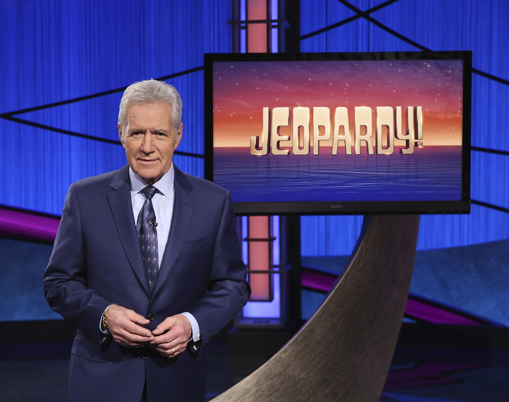"""This image released by Jeopardy! shows Alex Trebek, host of the game show """"Jeopardy!"""" The program won outstanding game show at the 47th annual Daytime Emmy Awards. (Jeopardy! via AP)"""