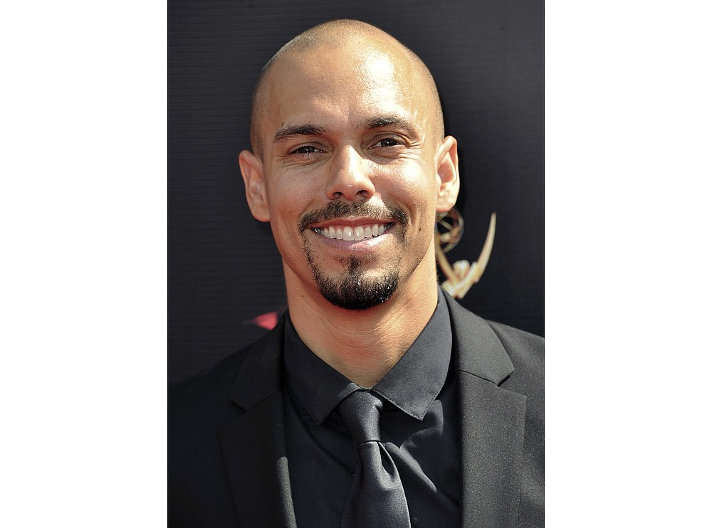 """FILE - In this May 5, 2019 file photo, actor Bryton James arrives at the 46th annual Daytime Emmy Awards in Pasadena, Calif. On Friday, June 26, 2020, James won the award for outstanding supporting actor in a drama series at the 47th annual Daytime Emmy Awards for his role on """"The Young and the Restless."""" (Photo by Richard Shotwell/Invision/AP, File)"""