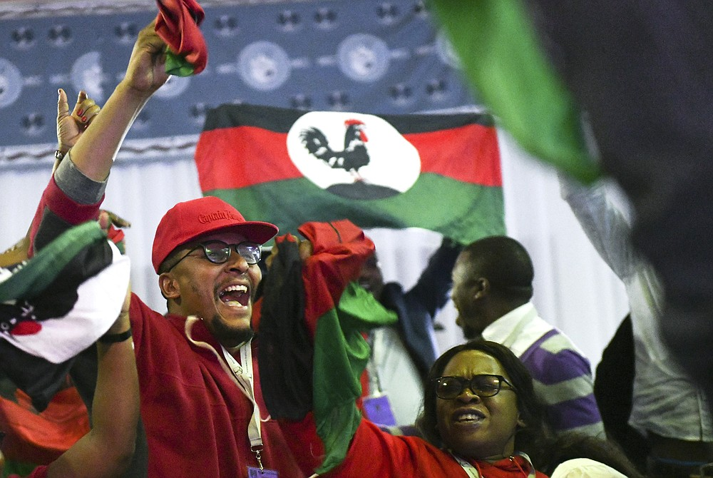 Malawi Congress Party supporters celebrate after party leader Lazarus Chakwera was announced the winner of Tuesday's election rerun in Blantyre, Malawi, Saturday, June 27, 2020. The opposition has won Malawi's historic rerun of the presidential election. It's the first time a court-overturned vote in Africa has led to the defeat of an incumbent leader (AP Photo/Thoko Chikondi)