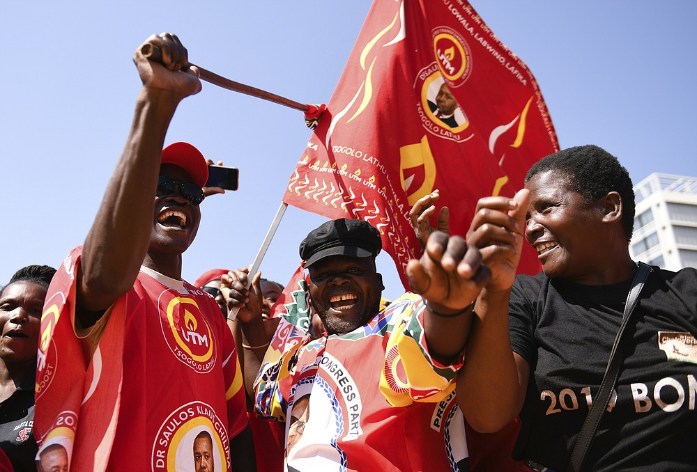 Party supporters attend the inauguration of Malawi's newly elected President Lazarus Chakwera in Lilongwe, Malawi, Sunday, June 28 2020. Chakwera is Malawi's sixth president after winning the historic election held last week, the first time a court-overturned vote in Africa has resulted in the defeat of an incumbent leader. (AP Photo/Thoko Chikondi)