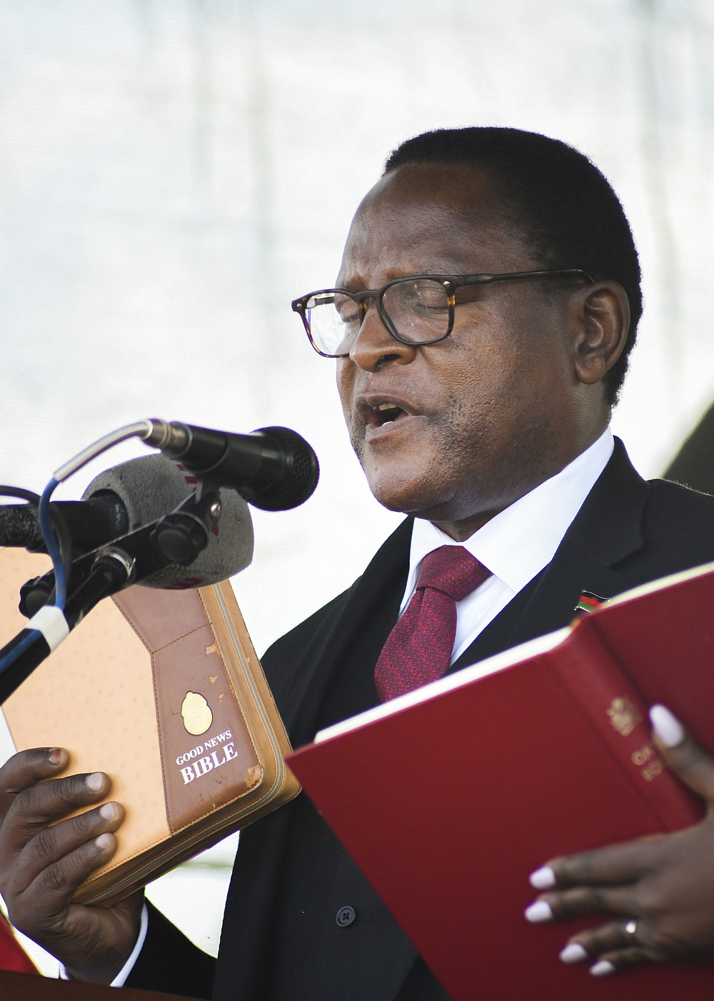 Malawi's newly elected President Lazarus Chakwera takes the oath of office in Lilongwe, Malawi, Sunday, June 28 2020. Chakwera is Malawi's sixth president after winning the historic election held last week, the first time a court-overturned vote in Africa has resulted in the defeat of an incumbent leader. (AP Photo/Thoko Chikondi)