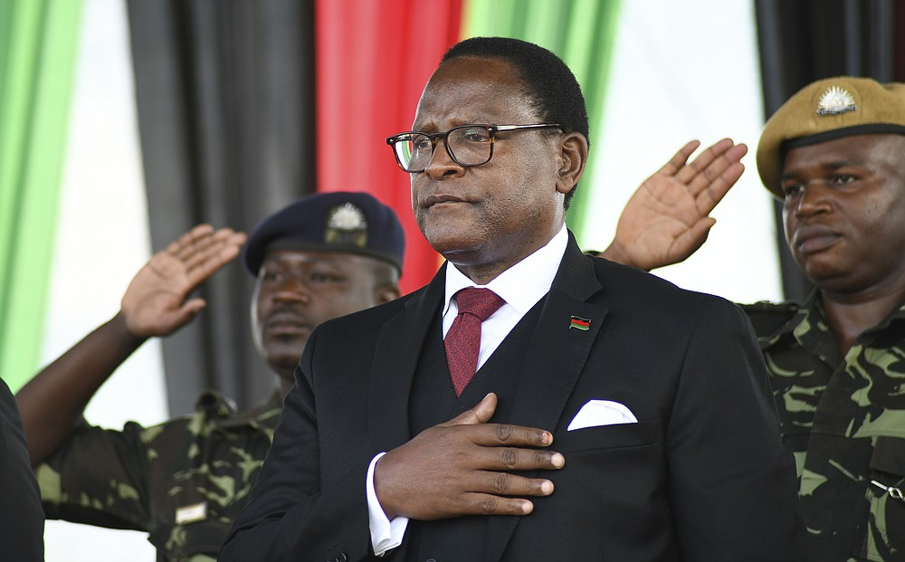 Malawi's newly elected President Lazarus Chakwera takes the oath of office in Lilongwe, Malawi, Sunday June 28, 2020.  Chakwera is Malawi's sixth president after winning the historic election held last week, the first time a court-overturned vote in Africa has resulted in the defeat of an incumbent leader. (AP Photo/Thoko Chikondi)