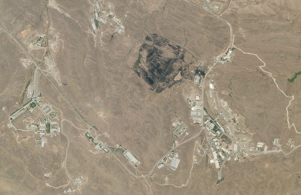 This Saturday, June 27, 2020, satellite image from Planet Labs shows the site of an explosion that rattled Iran's capital. Analysts say the blast Friday, June 26, 2020 came from an area in Tehran's eastern mountains they hides a underground tunnel system and missile production sites. The explosion appears to have charred hundreds of meters of scrubland. (Planet Labs via AP)