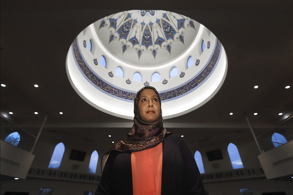"""In this Monday, June 22, 2020, photo, Hind Makki, poses for a portrait at the The Prayer Center of Orland Park in Orland Park, Ill. Makki remembers how, as a young girl, she would call out others at the Islamic school she attended when she heard an Arabic word that means """"slave"""" casually used to refer to Black people. """"Maybe 85% of the time, the response I would get from people...is 'Oh, we don't mean you, we mean the Americans,'"""" Makki said during a virtual panel discussion on race. (AP Photo/Charles Rex Arbogast)"""