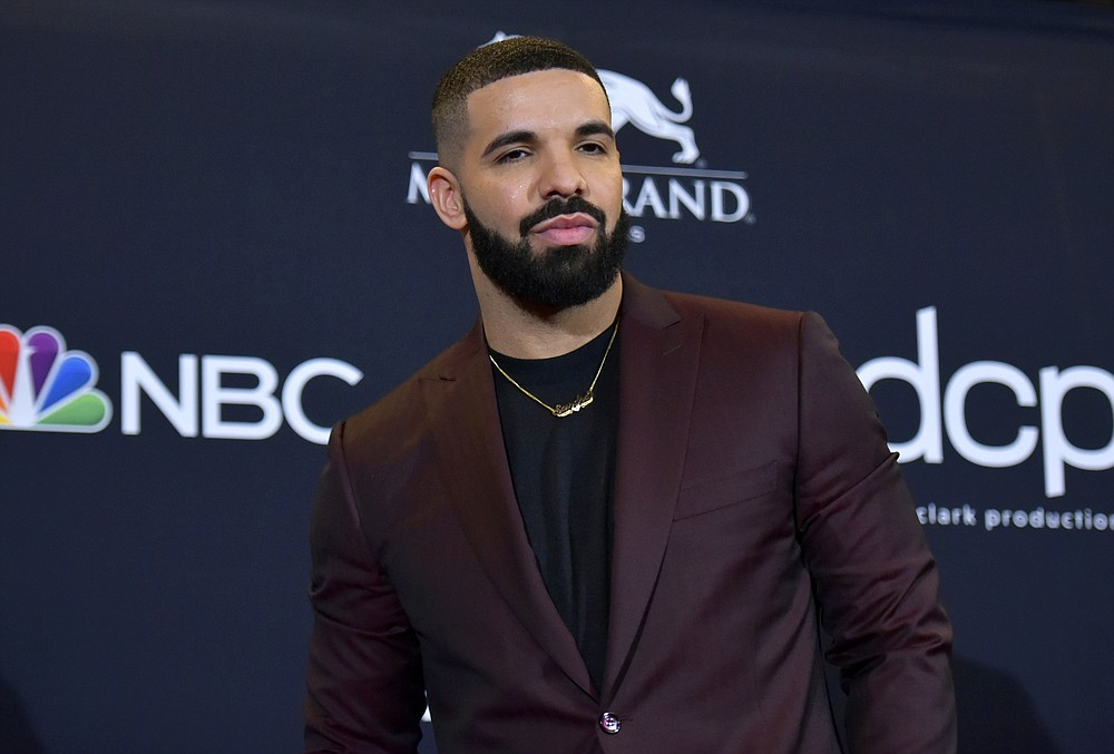 "FILE - This May 1, 2019 file photo shows Drake at the Billboard Music Awards in Las Vegas.  Drake is the leading nominee at the 2020 BET Awards, which will celebrate its 20th anniversary later this month. BET announced Monday that Drake is nominated for six honors, including video of the year and best male hip-hop artist. For both best collaboration and the viewer's choice award, Drake is nominated twice thanks to the hits ""No Guidance"" with Chris Brown and ""Life Is Good"" with Future. (Photo by Richard Shotwell/Invision/AP, File)"