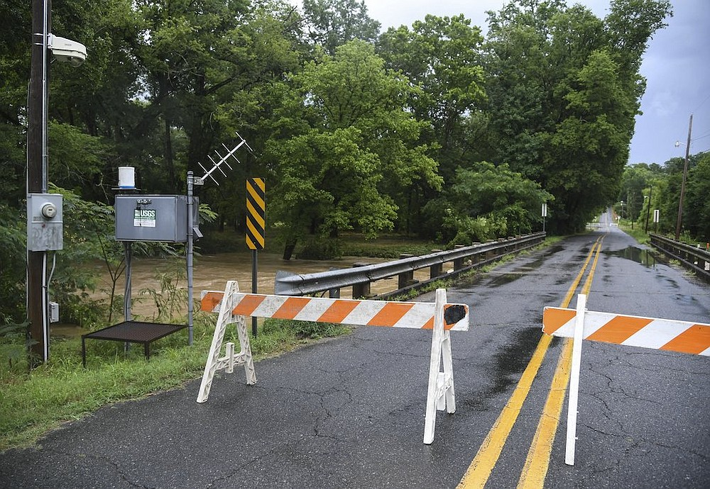 Barricades block a bridge on Ridgeway Street due to high water from Gulpha Creek on Monday, June 29, 2020, after heavy rains. - Photo by Grace Brown of The Sentinel-Record