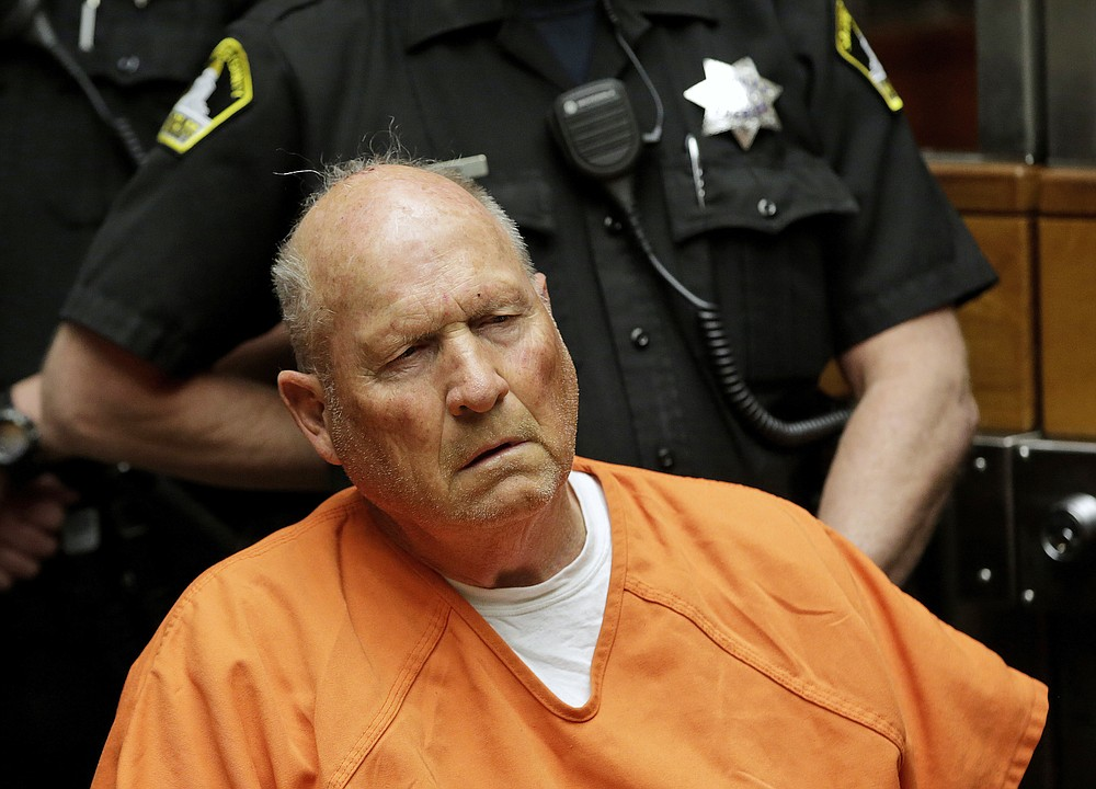 FILE - In this April 27, 2018 file photo Joseph James DeAngelo, is arraigned in Sacramento County Superior Court in Sacramento, Calif. The former police officer is tentatively set to plead guilty Monday, June 29, 2020, to being the elusive Golden State Killer. The hearing comes 40 years after a sadistic suburban rapist terrorized California in what investigators only later realized were a series of linked assaults and slayings. (AP Photo/Rich Pedroncelli, File)