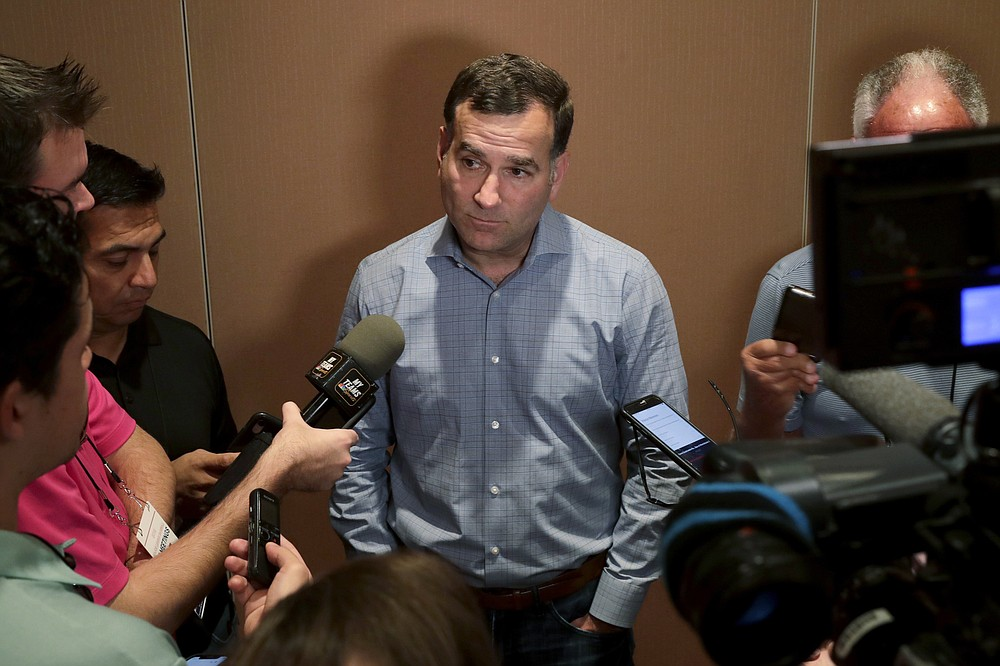 """FILE - This Nov. 12, 2019, file photo shows Chicago White Sox general manager Rick Hahn speaking during a media availability at the Major League Baseball general managers annual meetings in Scottsdale, Ariz. For a number of rebuilding teams, the 2020 baseball season was supposed to be another step in the progression of their top prospects eventually reaching the big leagues. """"It is affecting all 30 clubs,"""" Hahn said. """"And it is something that as we head into the fall, winter, the 2021 season we're going to have to adjust our expectations in terms of guys' pacing, in terms of guys' likelihood and timing at making an impact at the next level.""""(AP Photo/Matt York, File)"""
