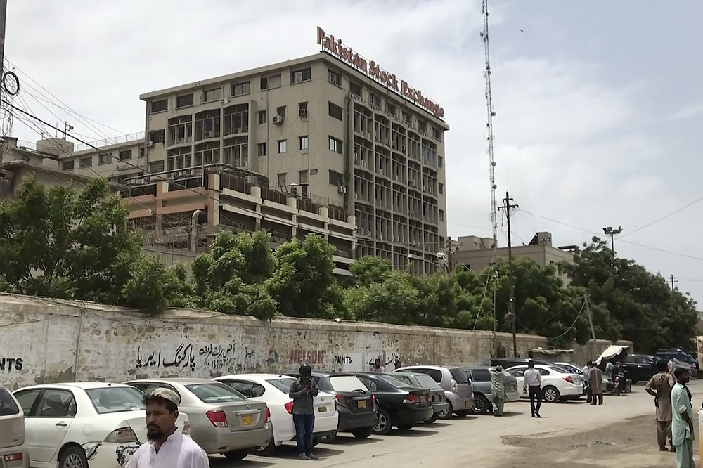 This image made from a video shows the exterior of stock exchange building in Karachi, Pakistan Monday, June 29, 2020. Militants attacked the stock exchange in the Pakistani city of Karachi on Monday, according to police. (AP Photo)