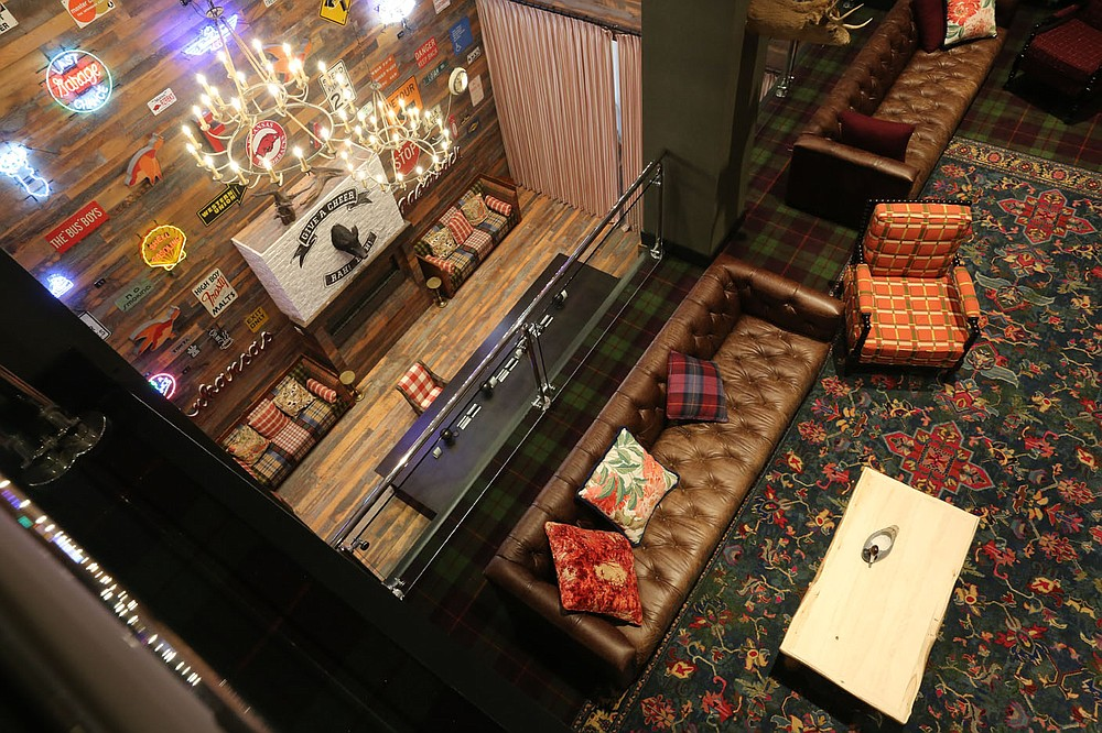 A view of a section of the lobby area riday, June 26, 2020, in the Graduate Fayetteville hotel in Fayetteville. Hotel, motel and restaurant sales tax collections fell significantly across the region in March and April when the pandemic prompted business closures across the state. Graduate Fayetteville reopened its doors to guests on Thursday. Check out nwaonline.com/200628Daily/ and nwadg.com/photos for a photo gallery. (NWA Democrat-Gazette/David Gottschalk)