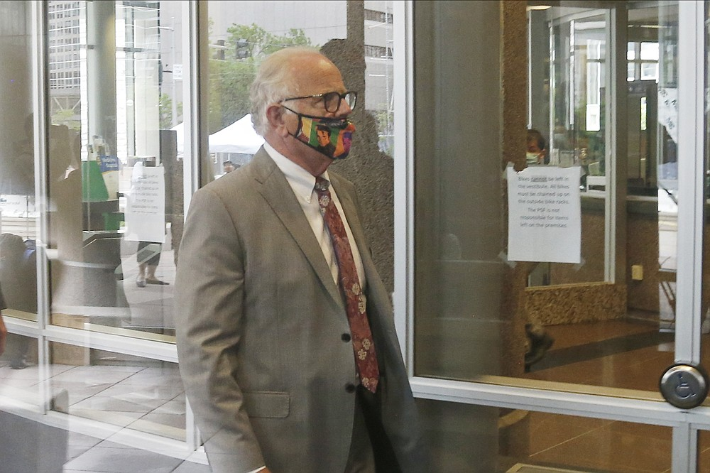 Earl Gray, attorney for former police officer Thomas Lane, leaves court Monday, June 29, 2020 following the second court appearance in Minneapolis for four former Minneapolis police officers facing charges ranging from second-degree murder to aiding and abetting murder in the Memorial Day death of George Floyd. Floyd died in police custody after video shared online by a bystander showed officer Derek Chauvin kneeling on Floyd's neck during his arrest as he pleaded that he couldn't breathe. (AP Photo/Jim Mone)