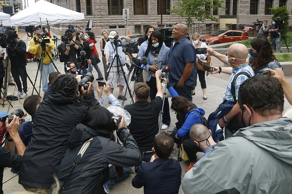George Floyd's uncle, Selwyn Jones, center, and his aunt, Angela Harrelson, to his right, address the media Monday, June 29, 2020 after the second court appearance in Minneapolis for four former Minneapolis police officers facing charges ranging from second-degree murder to aiding and abetting murder in the Memorial Day death of George Floyd. Floyd died in police custody after video shared online by a bystander showed officer Derek Chauvin kneeling on Floyd's neck during his arrest as he pleaded that he couldn't breathe. (AP Photo/Jim Mone)