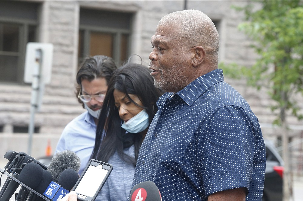 George Floyd's uncle, Selwyn Jones, right, and his aunt, Angela Harrelson, center, address the media Monday, June 29, 2020 after the second court appearance in Minneapolis for four former Minneapolis police officers facing charges ranging from second-degree murder to aiding and abetting murder in the Memorial Day death of George Floyd. Floyd died in police custody after video shared online by a bystander showed officer Derek Chauvin kneeling on Floyd's neck during his arrest as he pleaded that he couldn't breathe. (AP Photo/Jim Mone)