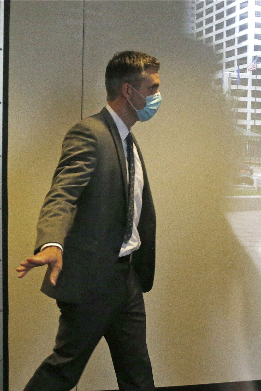 Former police officer Thomas Lane, left, leaves court Monday, June 29, 2020, following the second court appearance in Minneapolis of four former Minneapolis police officers facing charges ranging from second-degree murder to aiding and abetting murder in the Memorial Day death of George Floyd. Floyd died in police custody after a video shared online by a bystander showed officer Derek Chauvin kneeling on Floyd's neck during his arrest as he pleaded that he couldn't breathe. (AP Photo/Jim Mone)