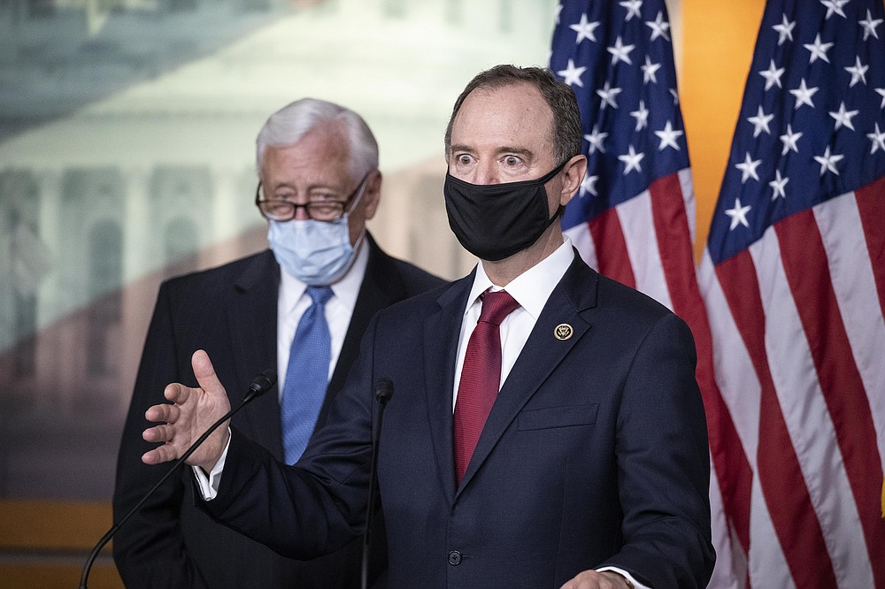 Rep. Adam Schiff, D-Calif., Chairman of the House Intelligence Committee, right, speaks accompanied by House Majority Leader Steny Hoyer of Md., during a news conference on Capitol Hill, after a meeting at the White House, Tuesday, June 30, 2020 in Washington. (AP Photo/Alex Brandon)