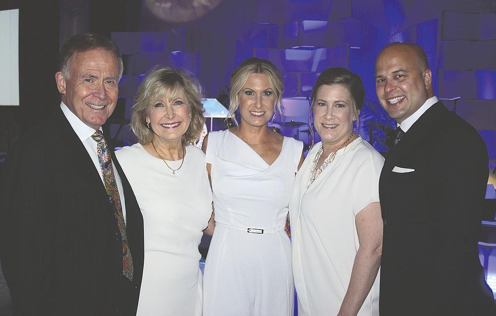 NWA Democrat-Gazette/CARIN SCHOPPMEYER David and Cathy Evans (from left) with their family  Erin Bridges and Linden and Brandon Seims help support ACH.