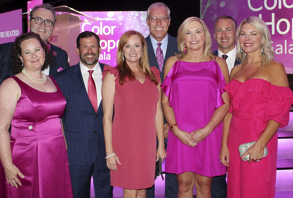 NWA Democrat-Gazette/CARIN SCHOPPMEYER Mary and Fred Scarborough (from left), Kyden and Melanie Reeh, Mike and Jill Sewell and Tony and Shelli Engle help support Arkansas Children's Northwest on Aug. 3.