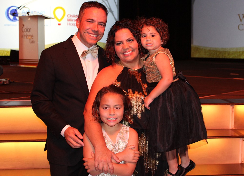 NWA Democrat-Gazette/CARIN SCHOPPMEYER Matt and Erin Johnson, with their daughters Sydney Johnson and Tori Johnson, Color of Hope Champion Child attend the benefit gala.