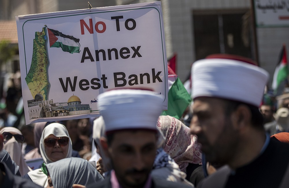 Palestinians demonstrate against Israeli plans for the annexation of parts of the West Bank, in Gaza City, Wednesday, July 1, 2020. (AP Photo/Khalil Hamra)