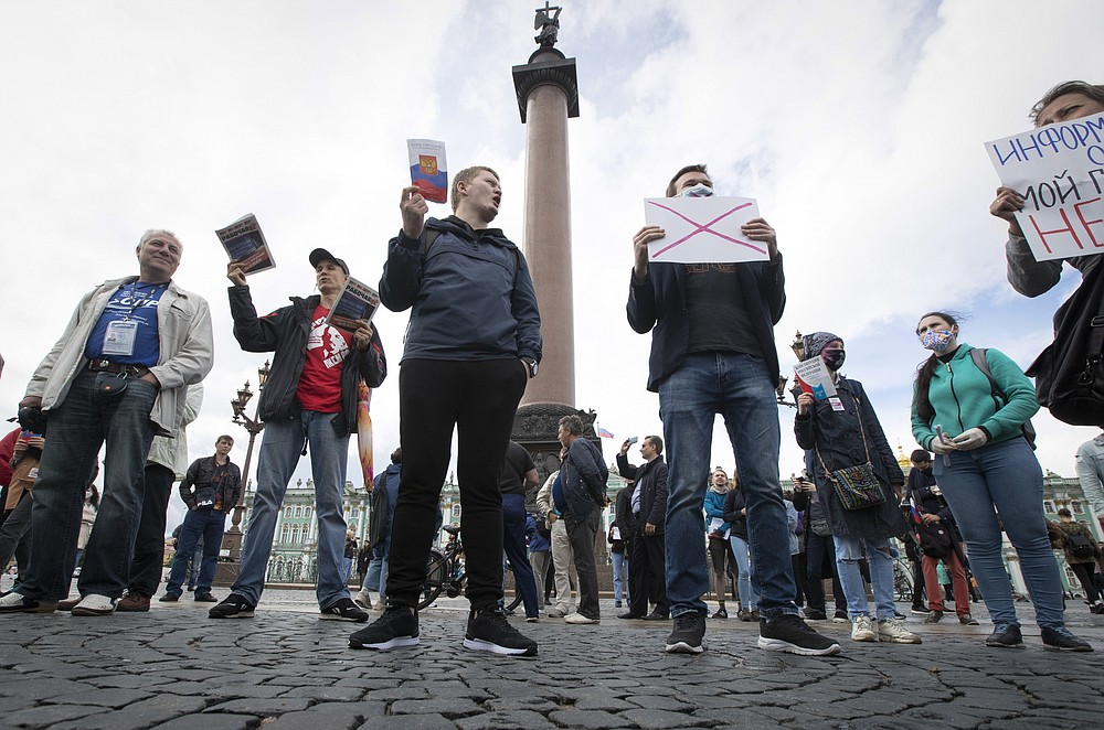 People protest against constitutional amendments on Palace Square in St. Petersburg, Russia, Wednesday, July 1, 2020. The vote on the constitutional amendments that would reset the clock on Russian President Vladimir Putin's tenure and enable him to serve two more six-year terms is set to wrap up Wednesday. (AP Photo/Dmitri Lovetsky).