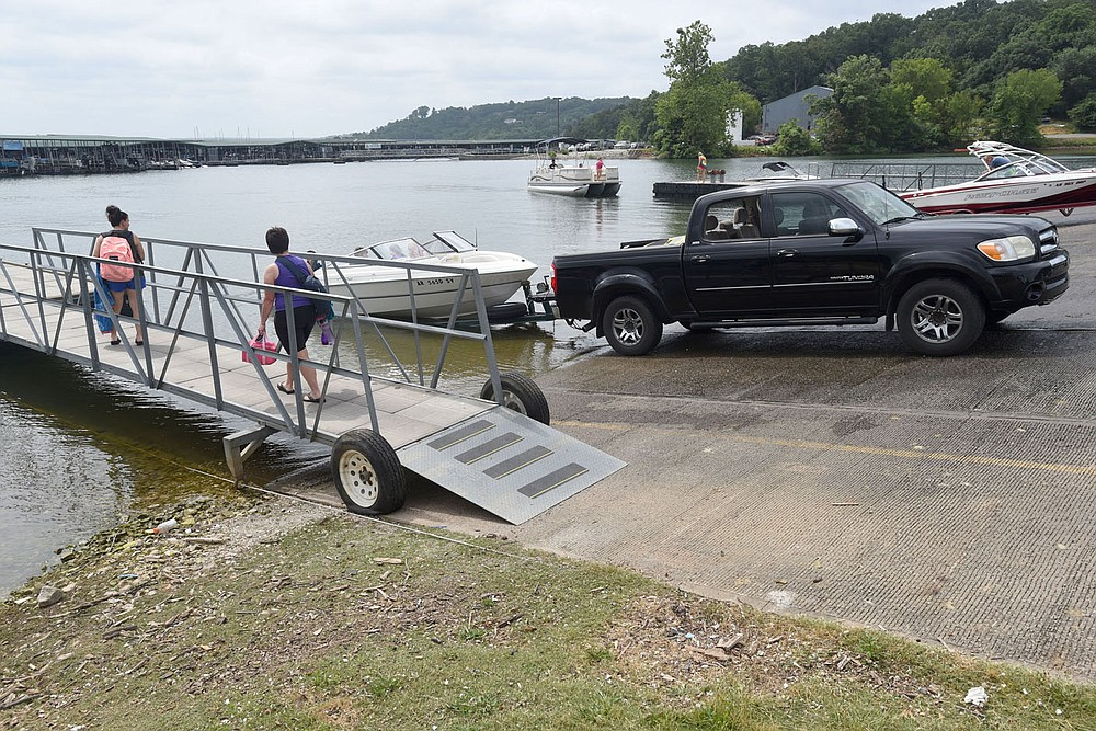 Boats are launched Wednesday July 1 2020 at Prairie Creek park on Beaver Lake. Independence Day weekend is one of the busiest at the lake. Go to nwaonline.com/200702Daily/ to see more photos. (NWA Democrat-Gazette/Flip Putthoff)