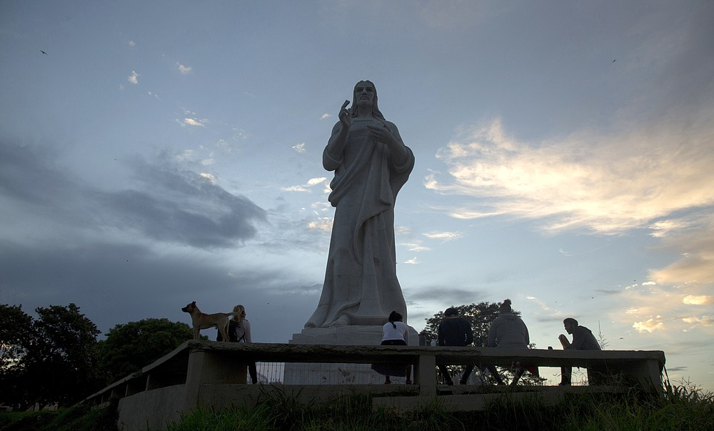 A Christ statue stands without tourists milling about, amid a lockdown affecting tourism to curb the spread of the COVID-19 pandemic in Havana, Cuba, Thursday, June 18, 2020. For state-run tourism, Cuba's success so far in controlling the coronavirus is becoming part of some companies' marketing plans. (AP Photo/Ismael Francisco)