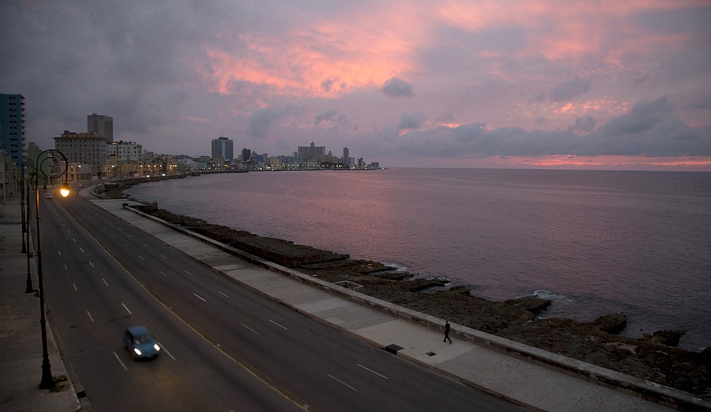 The Malecon waterfront is devoid of people during a lockdown to curb the spread of COVID-19 in Havana, Cuba, Thursday, June 18, 2020. With coronavirus cases down to a handful a day, Cuba is betting on a new form of tourism by designating five keys off its coast as all-inclusive vacation sites almost completely isolated from the rest of Cuba, in an attempt to restart a vital industry without reintroducing the virus to the country. (AP Photo/Ismael Francisco)