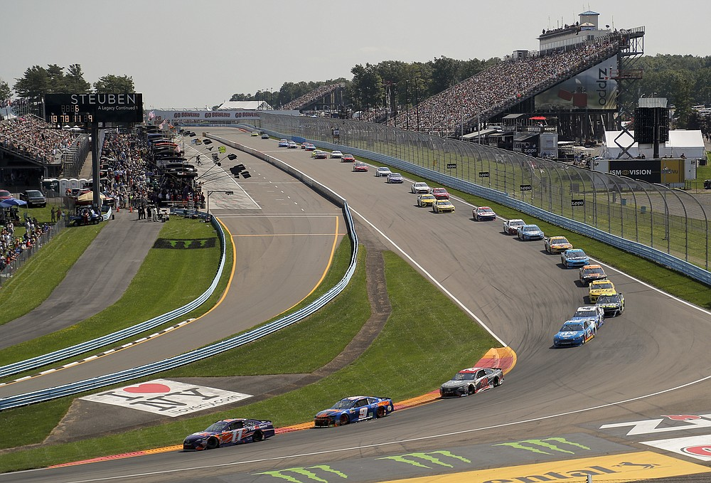 FILE - In this Aug. 5, 2018, file photo, Denny Hamlin (11), Chase Elliott (9) and Erik Jones (20) come around Turn 1 during a NASCAR Cup Series auto race in Watkins Glen, N.Y. NASCAR will move its August road course race from Watkins Glen in upstate New York because of state health restrictions, and the event will shift instead to the road course at Daytona International Speedway. NASCAR'S August schedule revisions announced Wednesday, July 8, 2020, cover six Cup races at three tracks.  (AP Photo/Julie Jacobson, File)