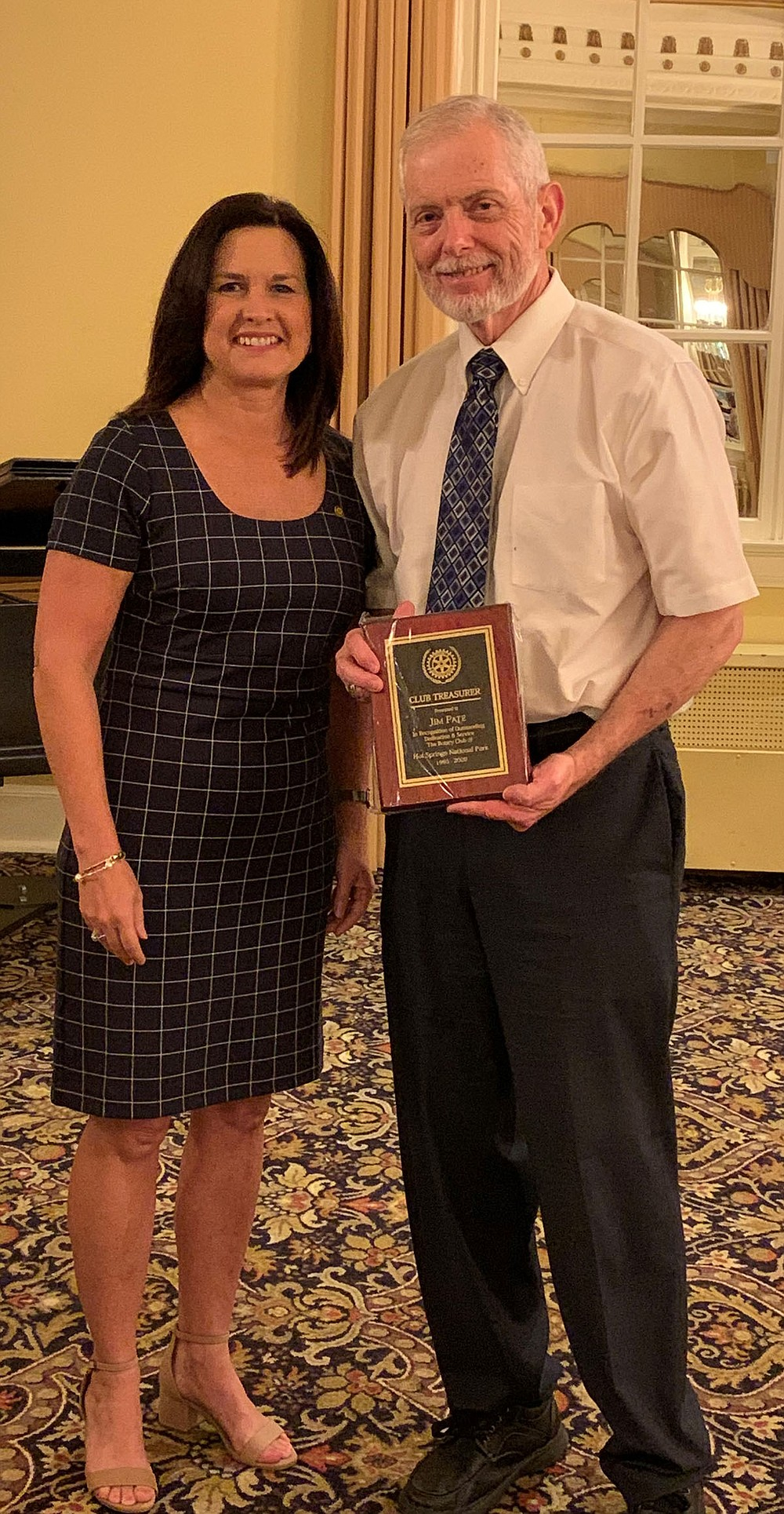 Michelle Ratcliff, left, immediate past president, with Jim Pate, who has served as club treasurer for 24 years. - Submitted photo