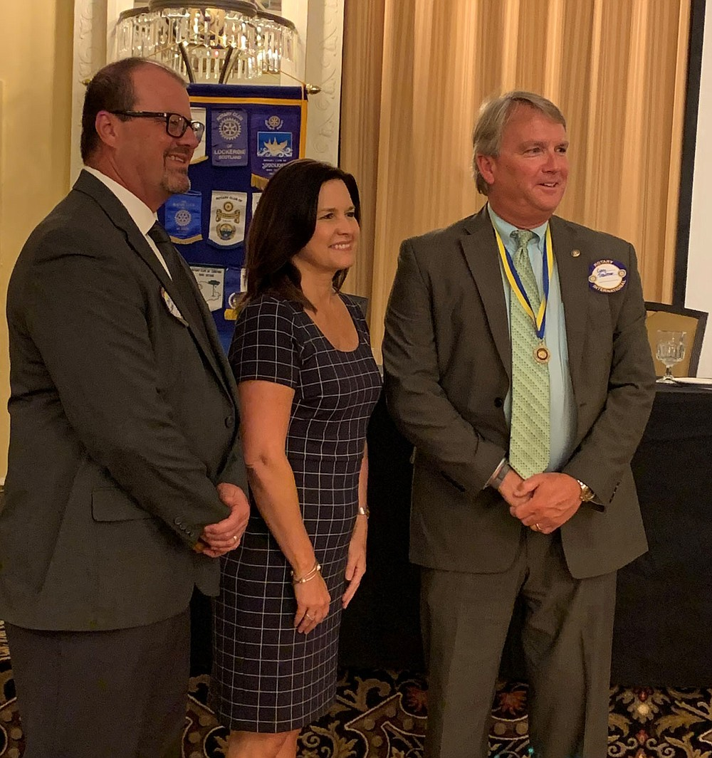 From left are Chuck Launius, incoming president, Michelle Ratcliff, immediate past president, and Gary Troutman, past president, who was named a Level Two Paul Harris Fellow. - Submitted photo