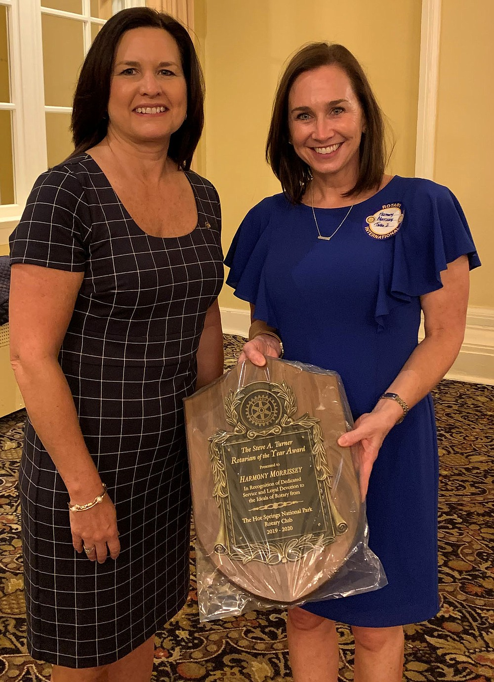 Michelle Ratcliff, left, immediate past president, with Rotarian of the Year Harmony Morrissey. - Submitted photo