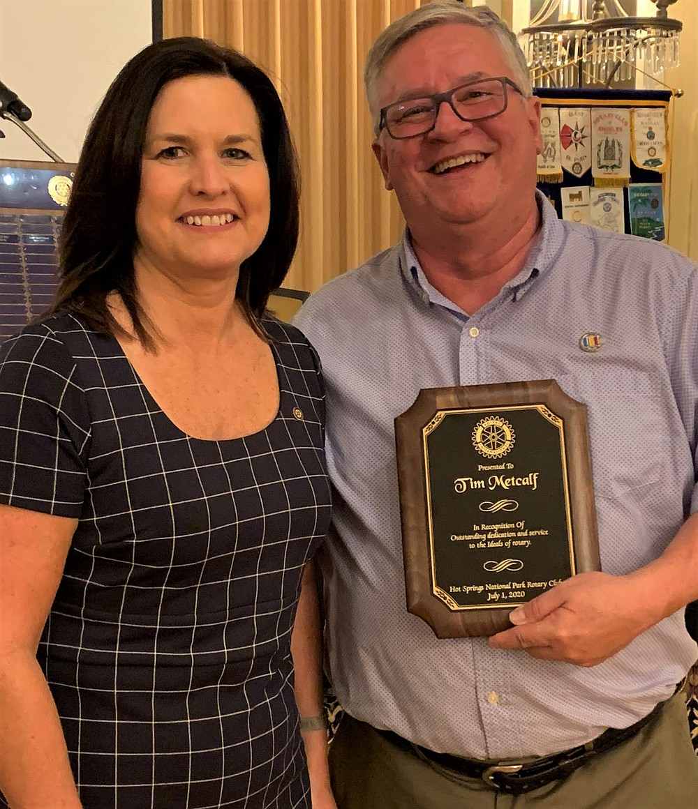 Michelle Ratcliff, left, immediate past president, with Tim Metcalf, who received a Special Recognition Award for his dedication and helping to create, and continuously help and support, the Satellite Club. - Submitted photo