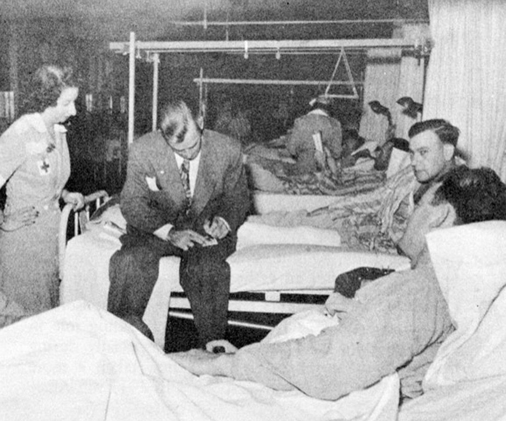 In 1946, movie star and Hot Springs native Alan Ladd signs autographs for patients at the Army and Navy General Hospital. Photo is courtesy of the Garland County Historical Society. - Submitted photo