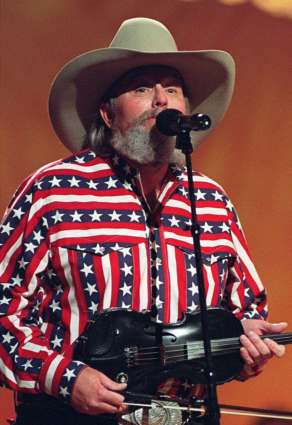"""FILE - Singer Charlie Daniels performs in Nashville, Tenn., on May 7, 1992. Daniels, who had a hit with """"Devil Went Down to Georgia"""" has died at age 83. A statement from his publicist said the Country Music Hall of Famer died Monday due to a hemorrhagic stroke. (AP Photo)"""