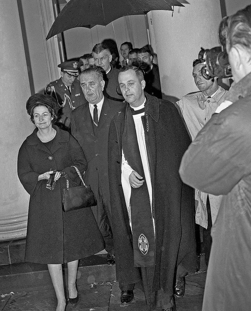 FILE - In this Nov. 23, 1963 file photo, President Lyndon Johnson and his wife, Lady Bird, leave St. John's Episcopal Church in Washington after attending special services. With them is the rector, the Rev. John C. Harper. Johnson was sworn in as president shortly after the assasisnation of John F. Kennedy in Dallas on Nov. 22. (AP Photo)