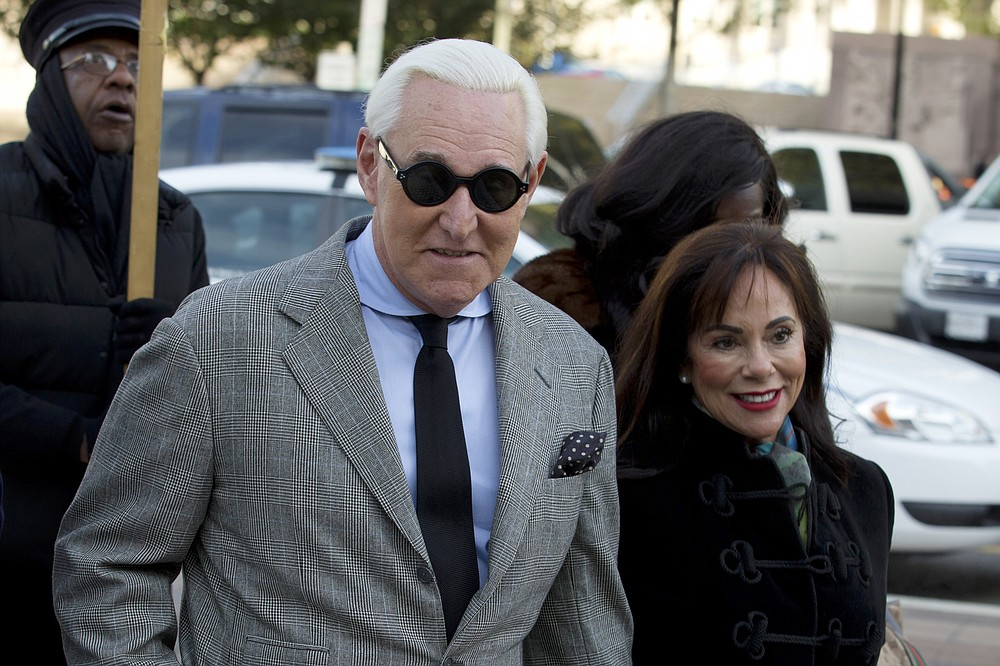 FILE - In this Nov. 14, 2019, file photo, Roger Stone accompanied by his wife Nydia Stone, right, arrives at federal court in Washington. (AP Photo/Jose Luis Magana, File)