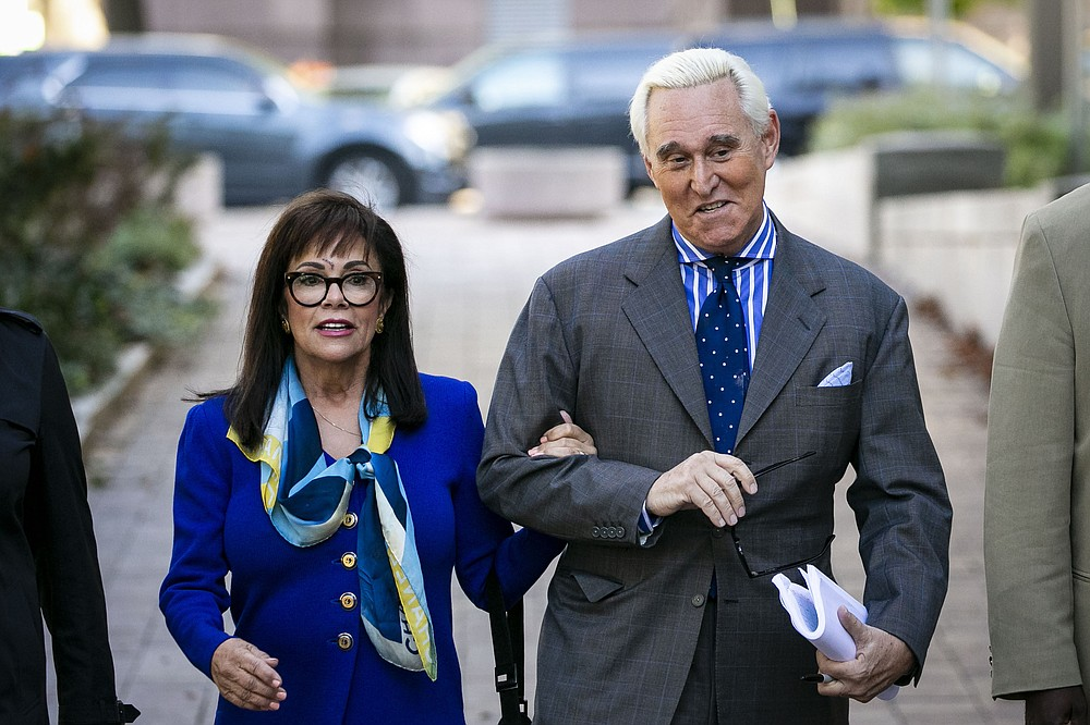 FILE - In this Nov. 8, 2019, file photo, Roger Stone, and his wife Nydia, arrive at federal court in Washington. (AP Photo/Al Drago, File)