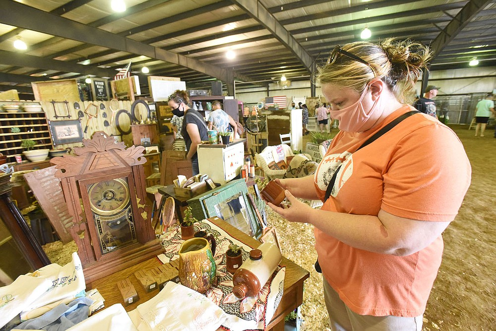 Kristy Sanders shops on Saturday July 11 2020 during Vintage Market Days at the Benton County Fairgrounds. The event continues today. Go to nwaonline.com/200712Daily/ to see more photos. (NWA Democrat-Gazette/Flip Putthoff)
