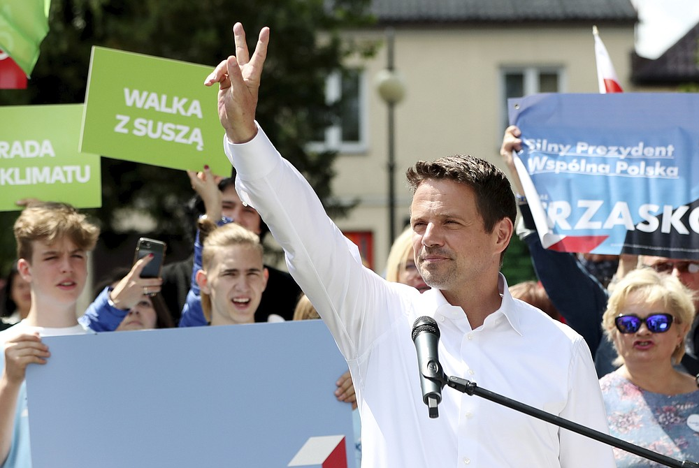 In this Thursday, July 9, 2020 photo Rafal Trzaskowski, contender in Poland's tight presidential election runoff on Sunday, July 12, 2020, gestures during a rally in Raciaz, Poland. Trzaskowski is running against incumbent conservative president, Andrzej Duda, who has backing from the ruling party. Opinion polls suggest the election may be decided by a small number of votes. (AP Photo/Czarek Sokolowski)