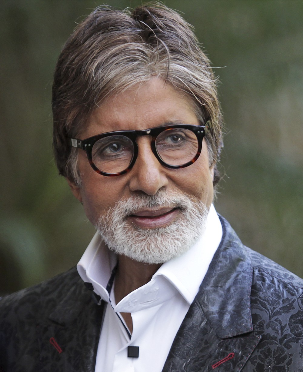 "FILE- In this Wednesday, Aug 21, 2013, file photo, Bollywood actor Amitabh Bachchan attends a promotional event for his upcoming movie ""Satyagraha"" in New Delhi, India. Bachchan has tested positive for COVID-19 and hospitalized in Mumbai, India's financial and entertainment capital. In a tweet on Saturday, July 11, 2020, Bachchan, 77, said his family and staff have also undergone tests and results are awaited. (AP Photo/Tsering Topgyal, File)"