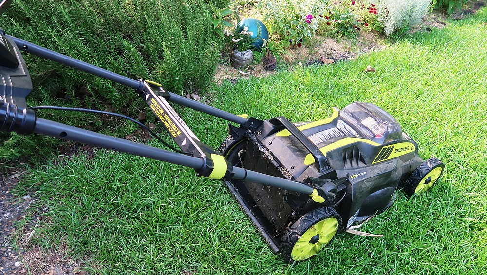 Electric mowers that are powered by batteries rather than hooked to extension cords are quiet, lightweight and inexpensive to operate but their batteries typically won't run longer than 45 minutes before needing a recharge. (Special to the Democrat-Gazette/Janet B. Carson)