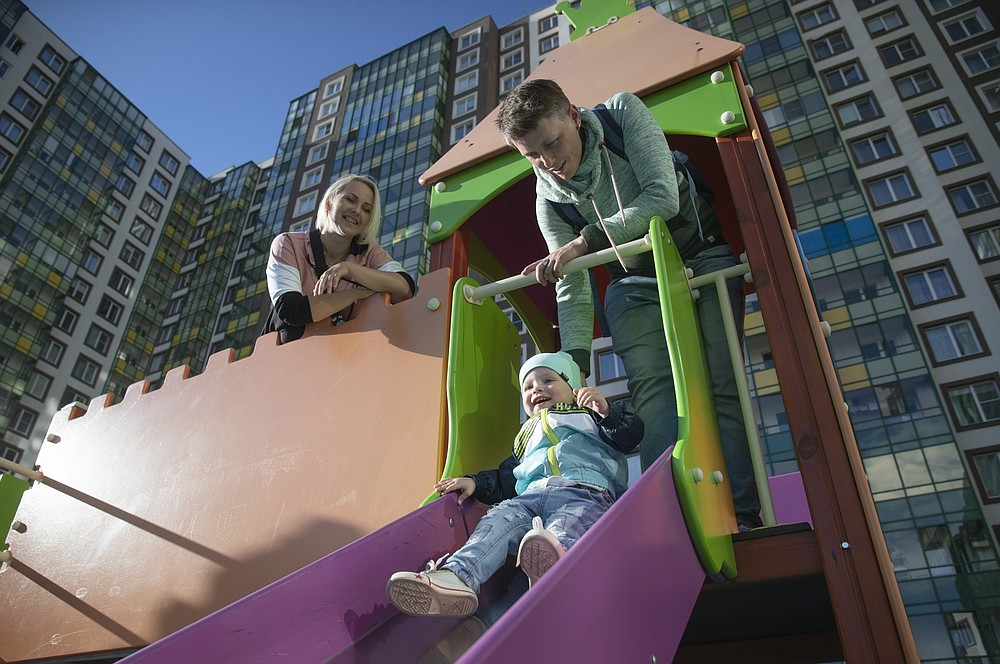 Irina, left, and Anastasia Lagutenko play with their son, Dorian, at a playground in St. Petersburg, Russia, Thursday, July 2, 2020. Their 2017 wedding was not legally recognized in Russia. Any hopes the couple could someday officially be married in their homeland vanished July 1 when voters approved a package of constitutional amendments, one of which stipulates that marriage in Russia is only between a man and a woman. (AP Photo)