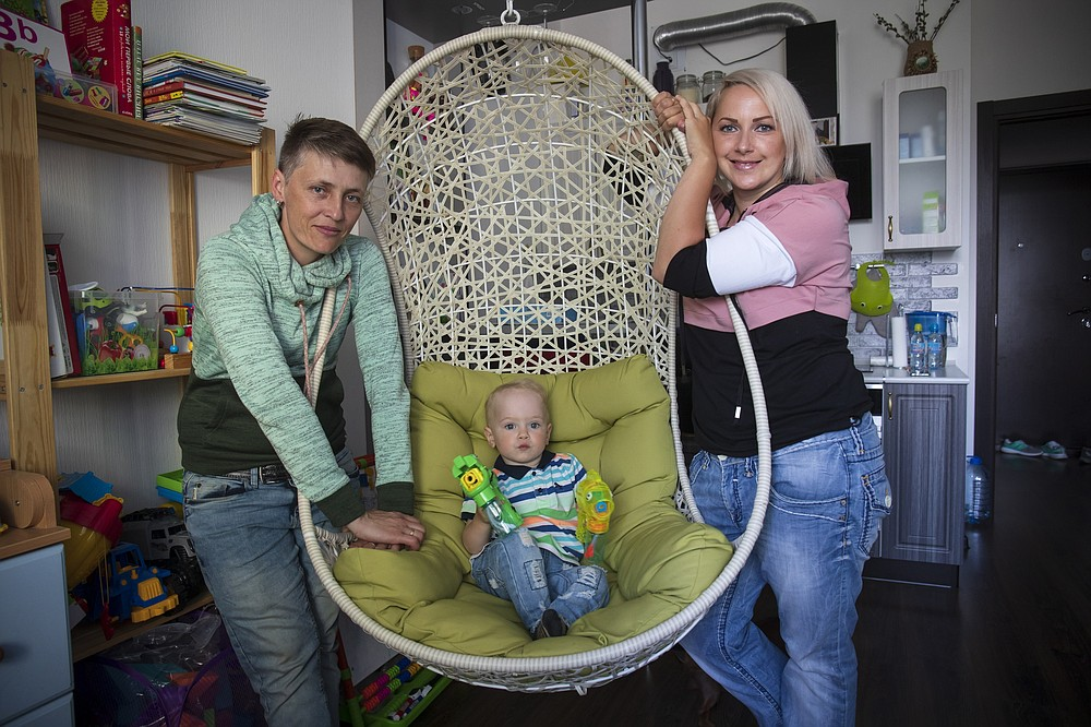 Irina, right, and Anastasia Lagutenko pose with their son, Dorian, in St. Petersburg, Russia, Thursday, July 2, 2020. Their 2017 wedding was not legally recognized in Russia. Any hopes they could someday officially be married in their homeland vanished July 1 when voters approved a package of constitutional amendments, one of which stipulates that marriage in Russia is only between a man and a woman. (AP Photo)