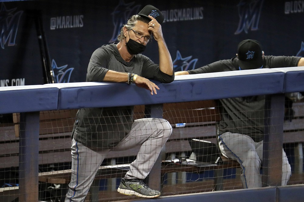 Miami Marlins manager Don Mattingly watches a baseball scrimmage at Marlins Park, Sunday, July 12, 2020, in Miami. (AP Photo/Lynne Sladky)