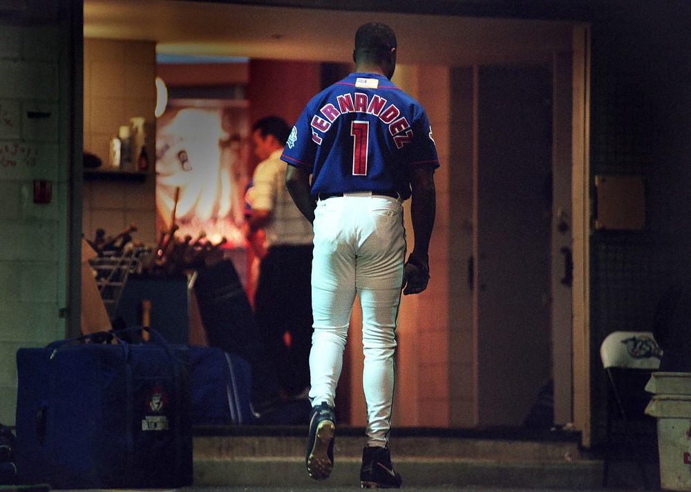 FILE - In this Oct. 7, 2001, file photo, Toronto Blue Jays' Tony Fernandez walks the tunnel to the clubhouse after pinch-hitting n the eighth inning against the Cleveland Indians in a baseball game in Toronto, his last game in the majors. The Blue Jays will honor the late Fernandez by wearing a patch with his No. 1 on the left sleeve of uniform jerseys this season. Fernandez had kidney problems and died Feb. 16, 2020, at age 57. (Fred Thornhill/The Canadian Press via AP, File)